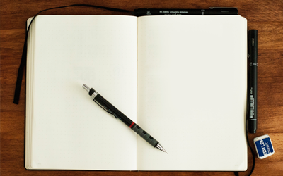 empty notebook with a pen in the middle