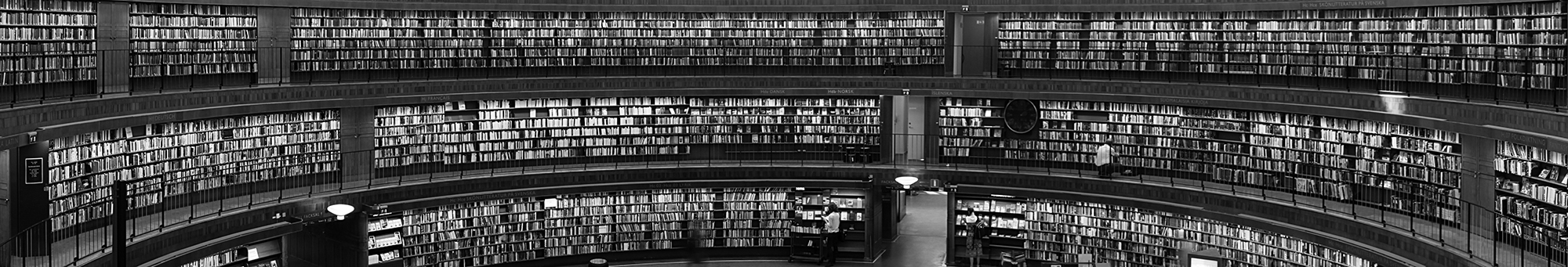 Banner - shelves full of books on the walls of a round room in a library