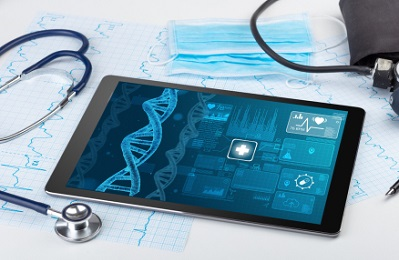 Ipad with a shot of DNA on computer with stethoscope and other medical tools