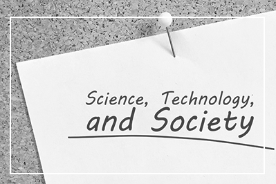 bulletin board with paper tacked on that reads science, technology, and society black and white