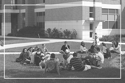 Students outside having open discussion in class