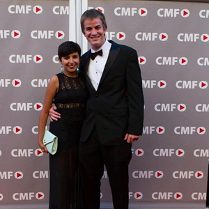 David Deeley and Henna Bakshi pose on the red carpet