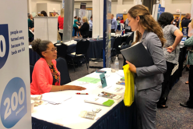 Student talking to an employer representative at a live career fair event