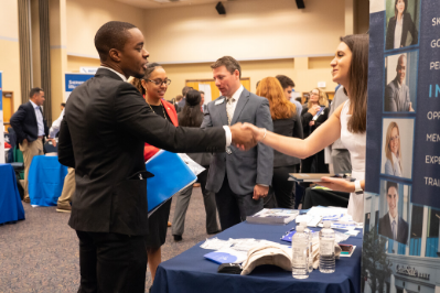 Man and woman shaking hands at a career event