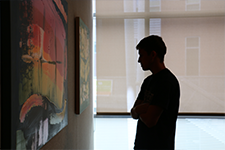 student browsing art gallery