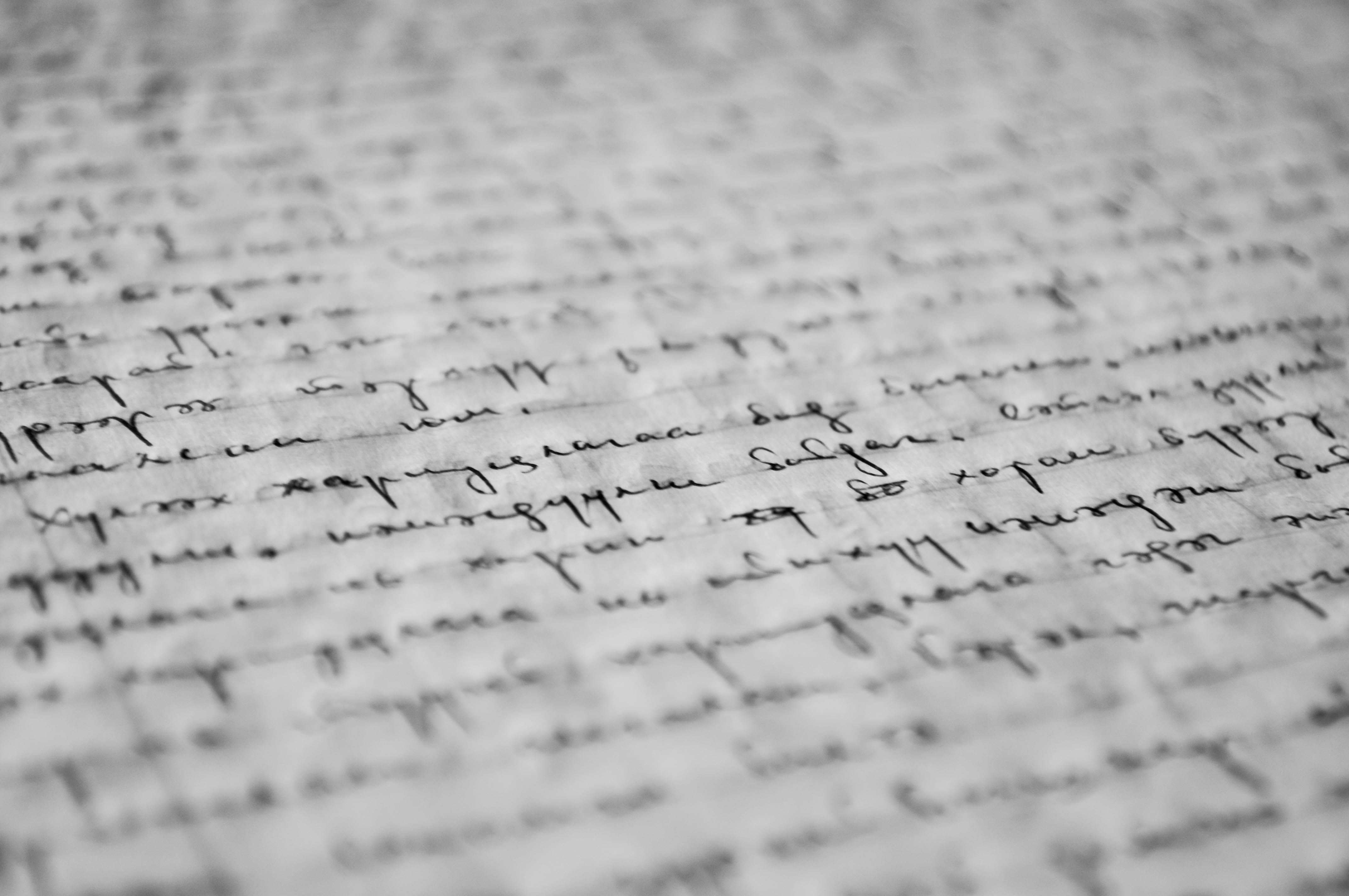 abstract black and white hand script on a blurred book