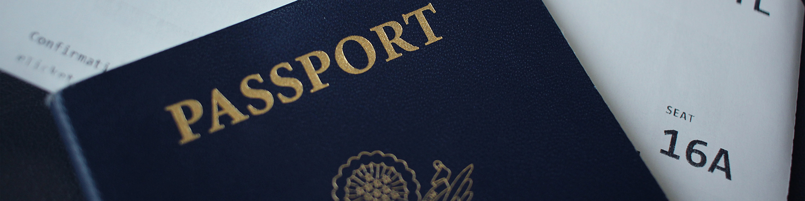 passport with a plane ticket