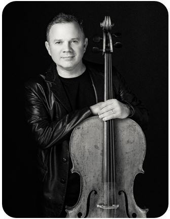 Nick Curry posing with his cello