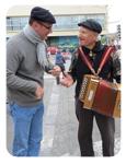 Scott Swan talking to an accordion player