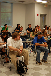 students listening to professor in classroom