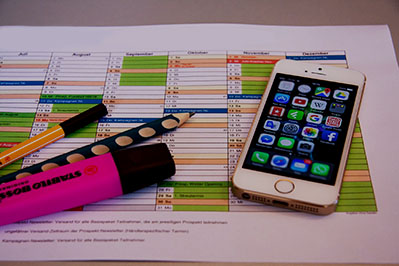 phone and stationery on planner