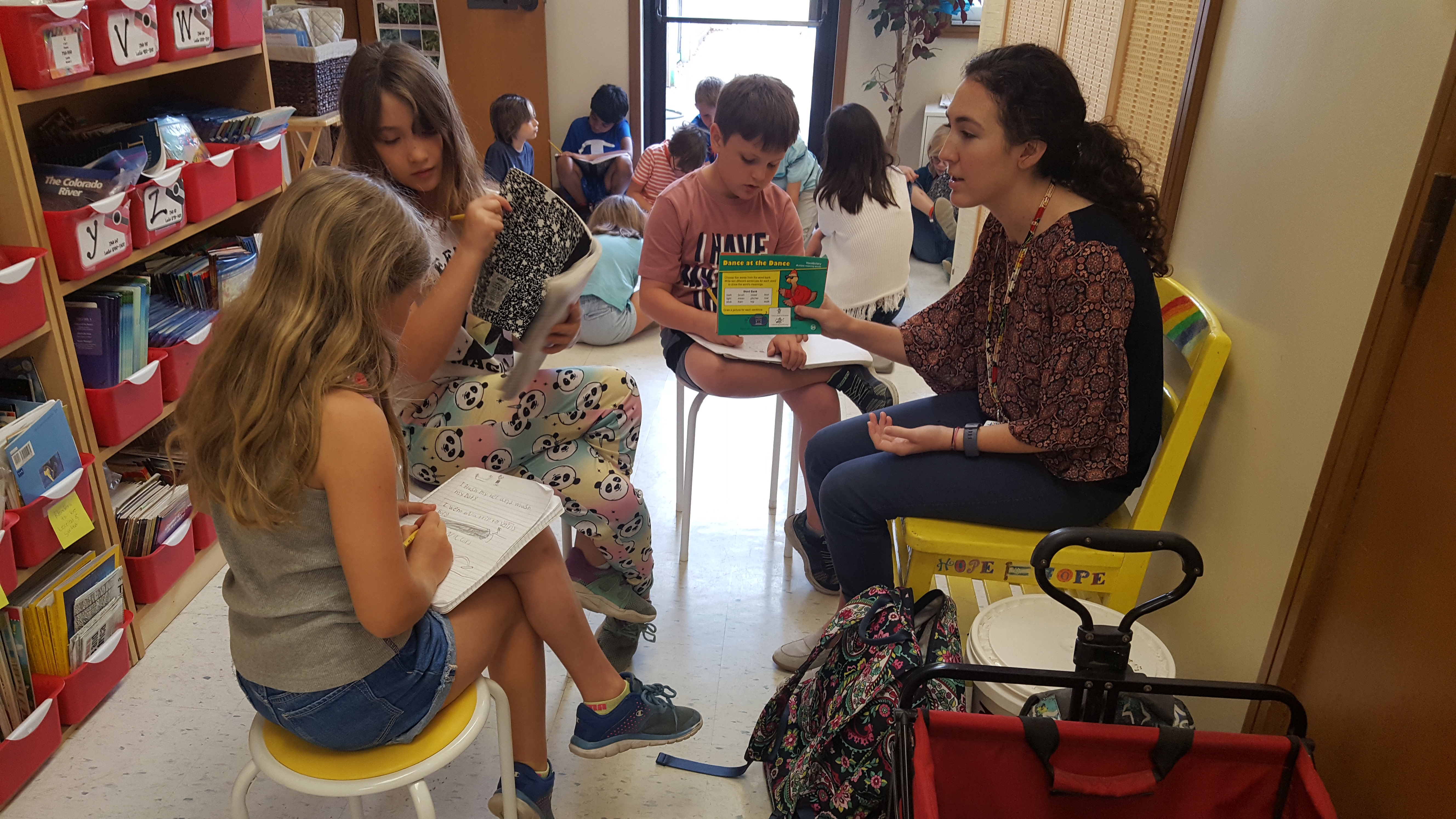 UNF student teaching children in a classroom setting