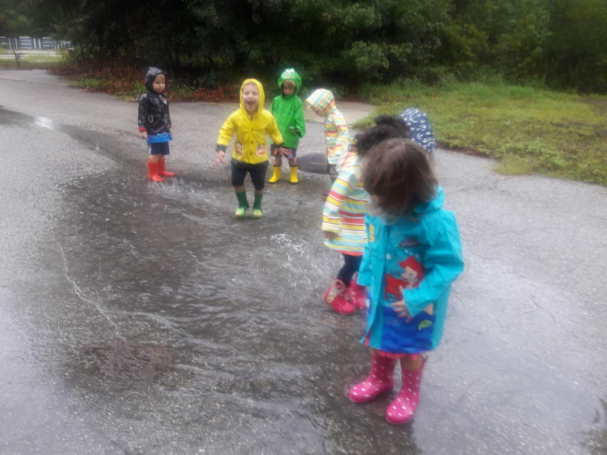 Kids play in rain