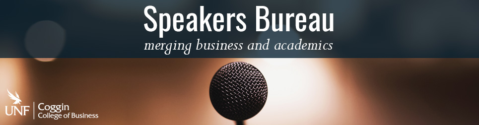 Speakers Bureau: merging business and academics. Close-up of microphone.