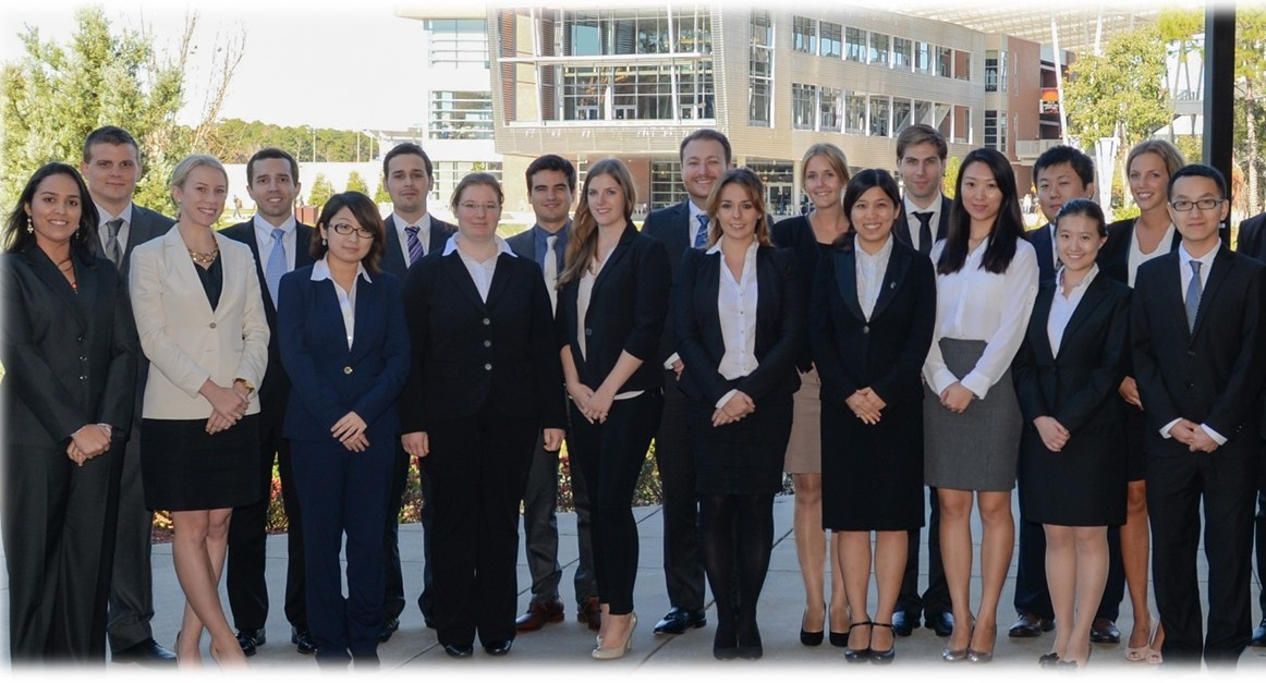 Group photo of Global MBA students in suits