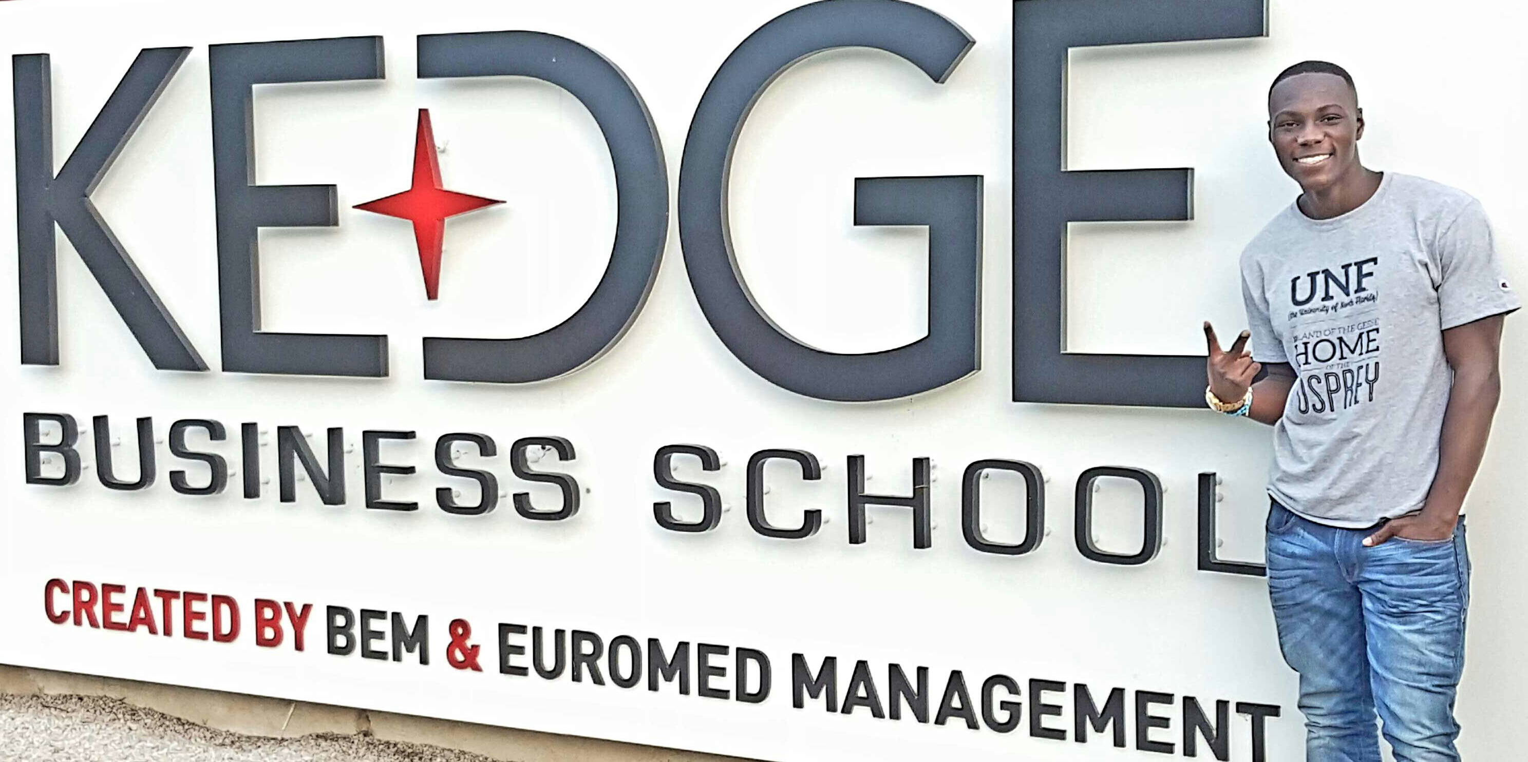 Student in Front of Kedge Business School sign