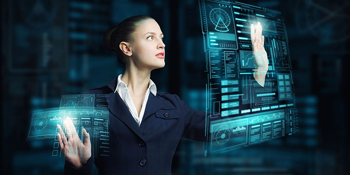 A business woman in a suit holding her hands up to a virtual screen
