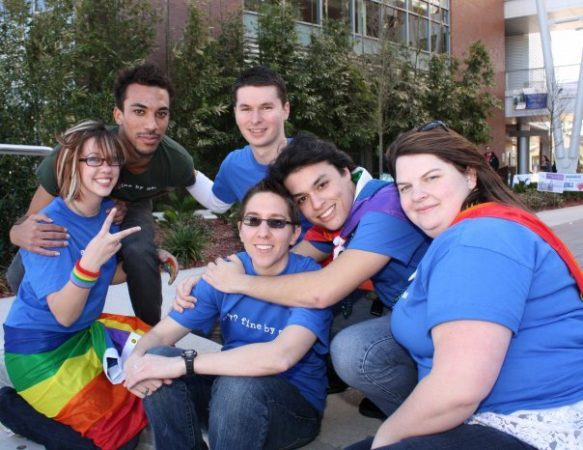 Group of people wearing rainbow merchandise