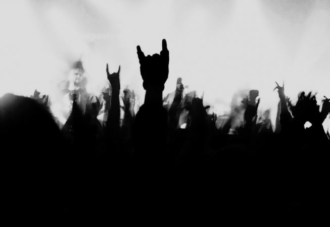 White background with shadow hands doing the rock and roll symbol