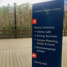 Campus sign showing where to go for Osprey Commons and Osprey Hall