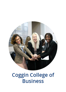 Three Coggin students smiling at camera