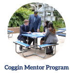 Coggin mentor program link -professor and students sitting at a table outside discussing class