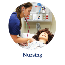 Nursing student practicing on a simulation doll