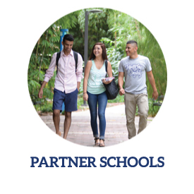 partner schools link with three students walking through bamboo garden