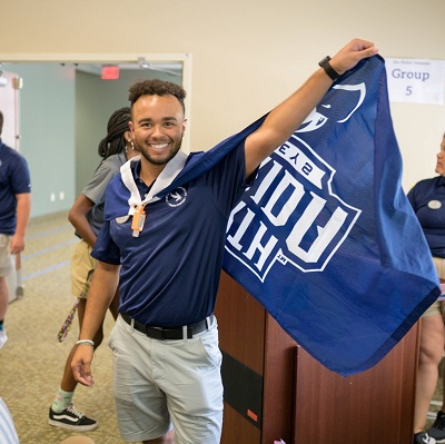 First Year New Student Orientation - kid with a UNF flag
