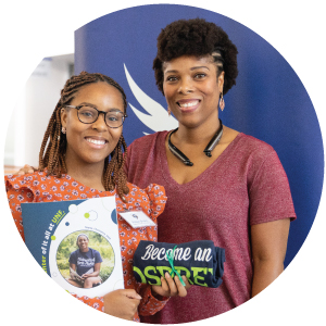 Mother and daughter posing for camera after being accepted into UNF