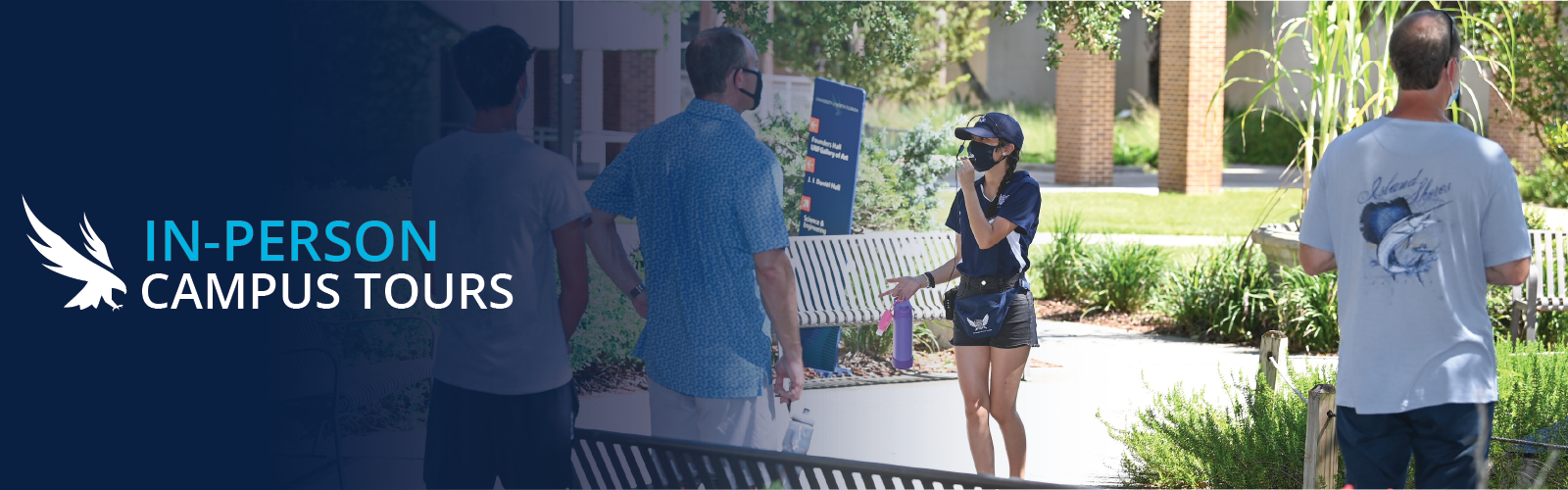 Tour guide wearing a mask speaking into a microphone with people around her with backs to the camera