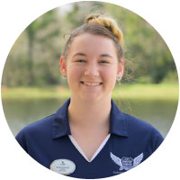 swoop squad member joanna smiling at camera wearing unf blue polo