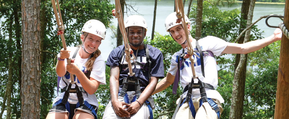 Three students on Ropes Course