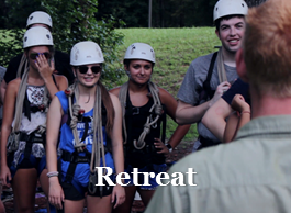 Photo of students participating in ropes course during retreat