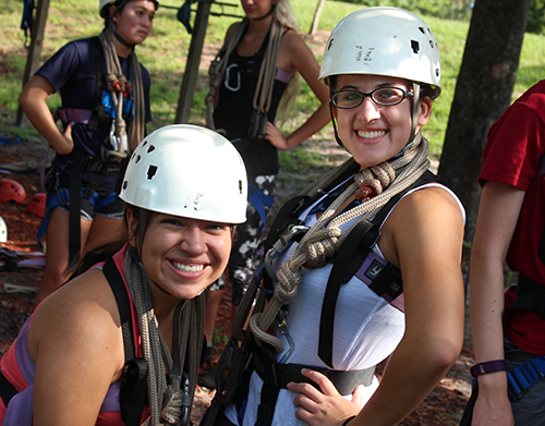 two girls on a ropes course