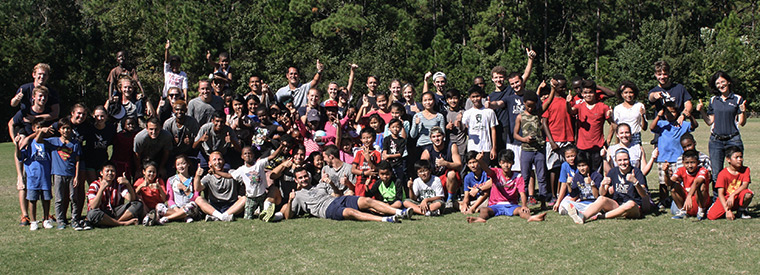Large group of UNF students and school kids posing for  a photo