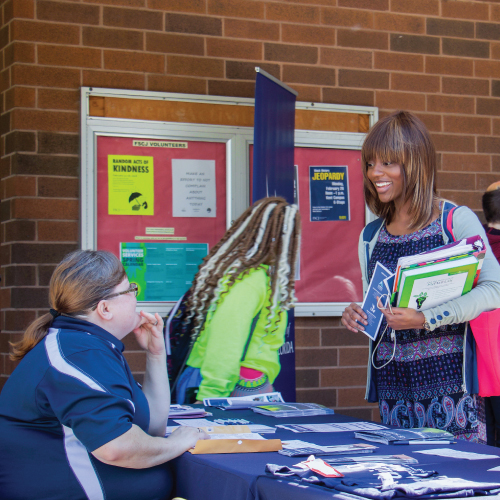 Potential student talking with a UNF representative at a event