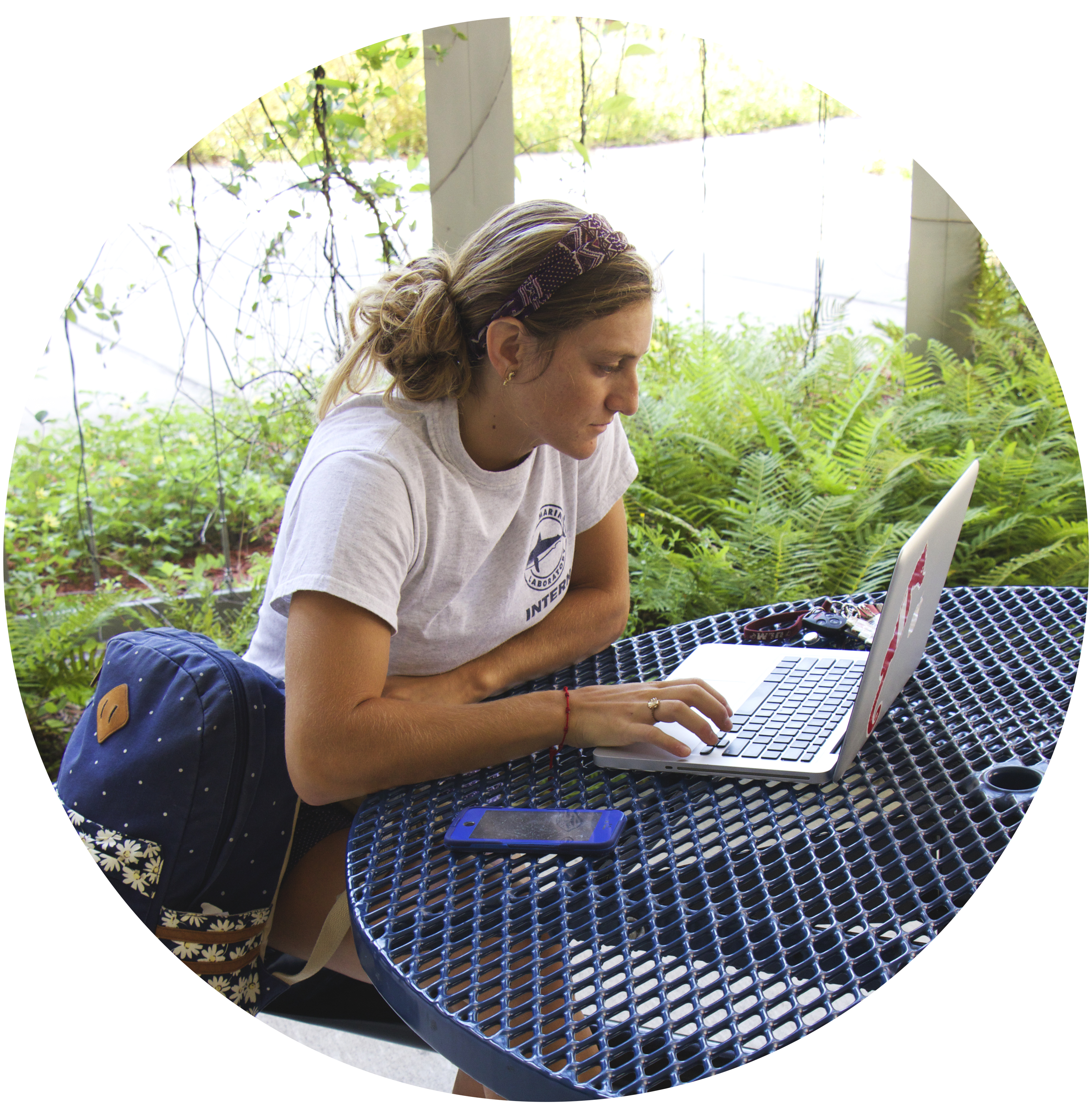 Student studying on her computer outside