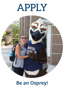 Mascot Ozzie with female student