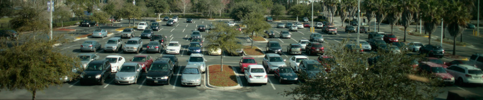 Parked vehicles in Lot 53 in front of Ann and David Hicks Hall, Building 53 on Kernan Boulevard