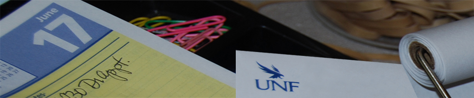 UNF letterhead on top of calendar dated June 17 and is top of colorful paperclips and rubberbands