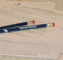 2 navy UNF Railroad Institute pencils laying on top of UNF form papers