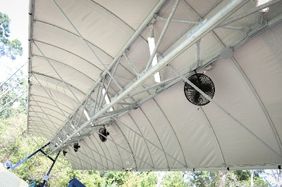 An underside view of canopy with fans to keep you cool during the day and  lights to see at night.