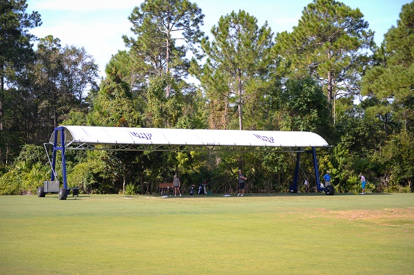A view of one of the UNF canopies with people training in its shade.