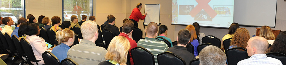 A group of guests enjoying a seminar
