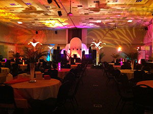 The Grand Banquet Hall set for a prom with gold, orange, and pink lighting