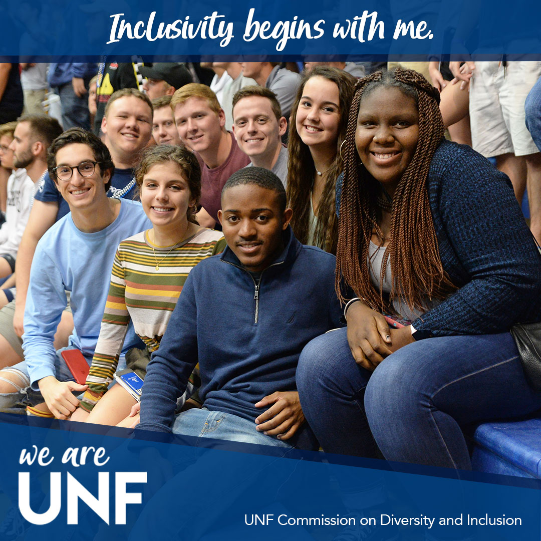 group smiling on  bleachers with text - Inclusivity Begins With Me - we are UNF