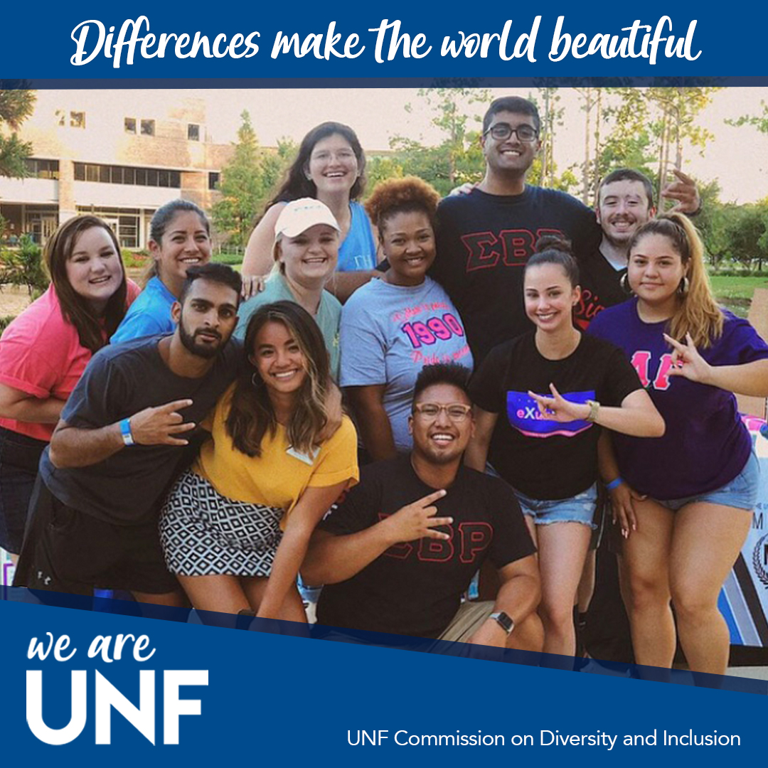 group smiling with peace signs up with text - Differences make the world beautiful - We are UNF
