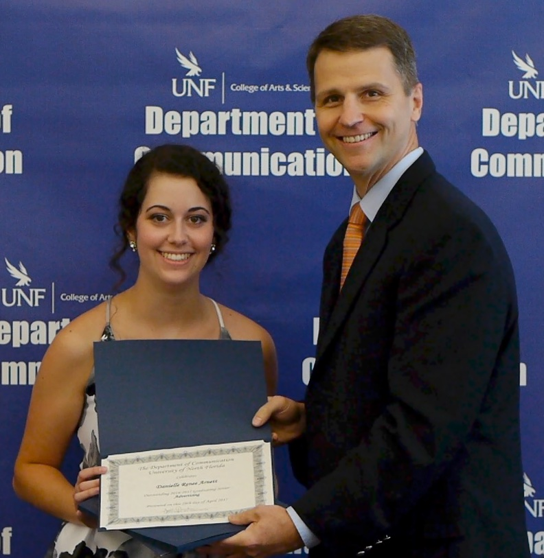 Danielle Arnett receives award from Dr. David Deeley