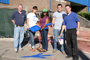 Spirit Advisory Board members (from left to right) Pete Morgan, Charlene Santiago, Yvette Kibwika, Alan Marsh and Elliot Darkatsh show off a freshly painted talon print near the UNF Aquatic Center
